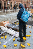 People protesting manifestation die-in against immigration policy and border management. STRASBOURG, FRANCE - APR 26 2015: Man looking at protest against royalty free stock photography