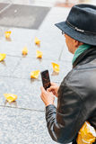 People protesting manifestation die-in against immigration policy and border management. STRASBOURG, FRANCE - APR 26 2015: Man photographing yellow paper boats royalty free stock photos