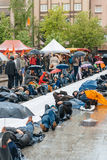 People protesting manifestation die-in against immigration policy and border management. STRASBOURG, FRANCE - APR 26 2015: Die-in protest against immigration royalty free stock photo
