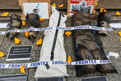 People protesting manifestation die-in against immigration policy and border management. STRASBOURG, FRANCE - APR 26 2015: Protest against immigration policy and stock photo