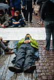People protesting manifestation die-in against immigration policy and border management. STRASBOURG, FRANCE - APR 26 2015: Die-in protest against immigration royalty free stock image
