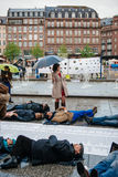 People protesting manifestation die-in against immigration policy and border management. STRASBOURG, FRANCE - APR 26 2015: Die-in protest against immigration royalty free stock photos