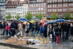 People protesting manifestation die-in against immigration policy and border management. STRASBOURG, FRANCE - APR 26 2015: Protest against immigration policy and stock images