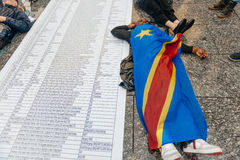People protesting manifestation die-in against immigration policy and border management. STRASBOURG, FRANCE - APR 26 2015: Die-in protest against immigration stock photos