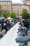 People protesting manifestation die-in against immigration policy and border management. STRASBOURG, FRANCE - APR 26 2015: Die-in protest against immigration stock photography