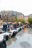 People protesting manifestation die-in against immigration policy and border management. STRASBOURG, FRANCE - APR 26 2015: Die-in protest against immigration royalty free stock photography