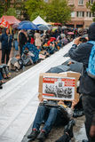 People protesting manifestation die-in against immigration policy and border management. STRASBOURG, FRANCE - APR 26 2015: Die-in protest against immigration stock photo