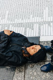 People protesting manifestation die-in against immigration policy and border management. STRASBOURG, FRANCE - APR 26 2015: Die-in protest against immigration stock images