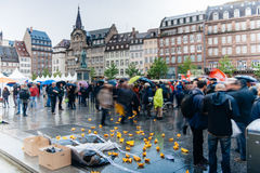People protesting manifestation die-in against immigration policy and border management. STRASBOURG, FRANCE - APR 26 2015: Protest against immigration policy and stock image