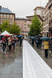 People protesting manifestation die-in against immigration policy and border management. STRASBOURG, FRANCE - APR 26 2015: People reading long list at protest stock photo