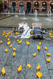 People protesting manifestation die-in against immigration polic. STRASBOURG, FRANCE - APR 26 2015: Yellow paper boats sand dead corpses at protest against Stock Images