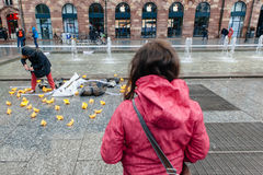 People protesting manifestation die-in against immigration policy and border management. STRASBOURG, FRANCE - APR 26 2015: Young woman looking at protest against stock images