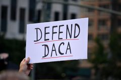 New York City. People protesting President Trump`s decision to repeal the Deferred Action for Childhood Arrivals DACA policy in Lower Manhattan Royalty Free Stock Photo