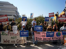 People protesting the President of the USA. SAN FRANCISCO, CA - OCTOBER 25: People protesting the President of the USA about Keystone XL, Drone Attacks, War and Stock Photo