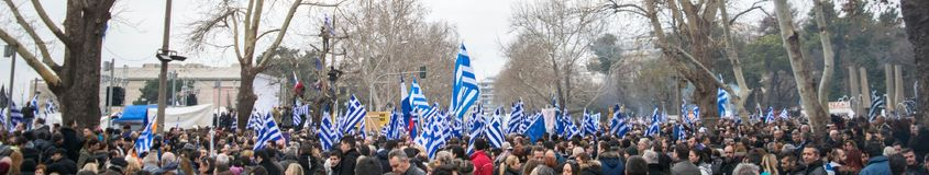 People protesting in the street. A picture of People in Thessaloniki Greece.protesting in the street with Greek flags in their hands,over the use of the name Royalty Free Stock Photo