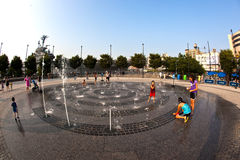 People in the public fountain area Royalty Free Stock Image