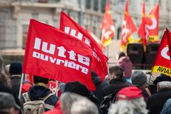 People from public service protesting with flags against the lower wages and new reforms from the government. Mulhouse - France - 19 March  2019 - people from royalty free stock images