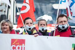 People from public service protesting with flags against the lower wages and new reforms from the government. Mulhouse - France - 19 March  2019 - people from stock photography
