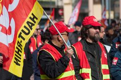 People from public service protesting with flags against the lower wages and new reforms from the government. Mulhouse - France - 19 March  2019 - people from royalty free stock photo