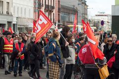 People from public service protesting with flags against the lower wages and new reforms from the government. Mulhouse - France - 19 March  2019 - people from stock photos