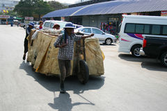People pull carts on the road in Thailand. Stock Photography