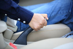 People pulling the car hand brake Royalty Free Stock Image
