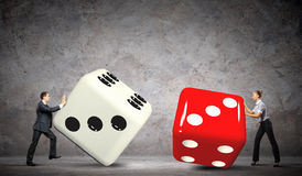 People pulling dices Royalty Free Stock Photography