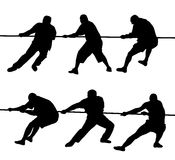 People pulling rope. Black silhouettes of people pulling rope Stock Photography