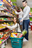 People purchasing food at supermarket Stock Photo
