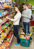 People purchasing food at supermarket Royalty Free Stock Images