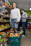 People purchasing food at supermarket Stock Photos