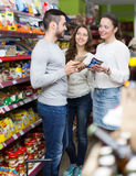 People purchasing food at supermarket Royalty Free Stock Photo