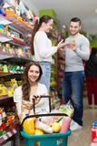 People purchasing food at supermarket Royalty Free Stock Photos
