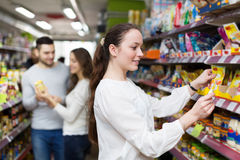 People purchasing food at supermarket Stock Photography