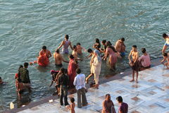 People purify themselves from sins in the Ganges in the holy city of Haridwar. India Stock Photography