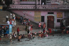 People purify themselves from sins in the Ganges in the holy city of Haridwar Stock Photos