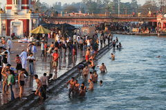 People purify themselves from sins in the Ganges in the holy city of Haridwar. India Stock Image