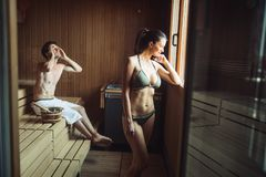 People pursuing healthy lifestyles relaxing in sauna stock photos