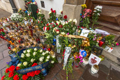 People put candles and flowers near the General Consulate of the French Republic to Krakow. Royalty Free Stock Photos
