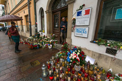 People put candles and flowers near the General Consulate of the French Republic to Krakow. Stock Photo