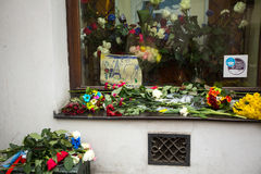 People put candles and flowers near the General Consulate of the French Republic to Krakow Royalty Free Stock Photography