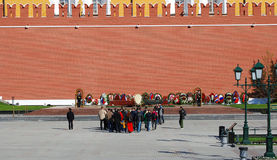 People put flowers to the tomb of unknown soldier in Moscow city center Royalty Free Stock Image