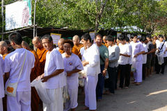 People put food offering to buddhist monk alms bowl which is the Stock Photo