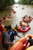 People Put Innertubes In Water To Tube Down Chattahoochee River. Duluth, GA / USA - July 14, 2018:  Groups of people put their innertubes and rafts in the royalty free stock photo