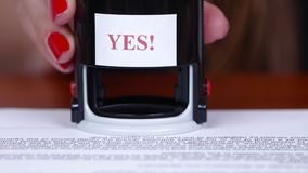 People puts the round stamp on the document. Close up stock footage