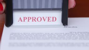 People puts a stamp on the document and endorses of cooperation. Close up stock footage
