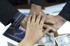 people putting hand together for business background stock image