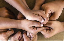 people putting their hands together ,concept successful people or team work Stock Image