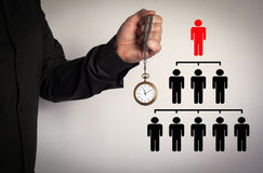 People pyramid with one leader at the top and silhouettes at all levels, business concept. Red Arrow and Icons Around. Man holding chain clock on white Royalty Free Stock Image