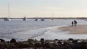 People in Quatro-Aguas East beach, at Tavira. Algarve. stock video